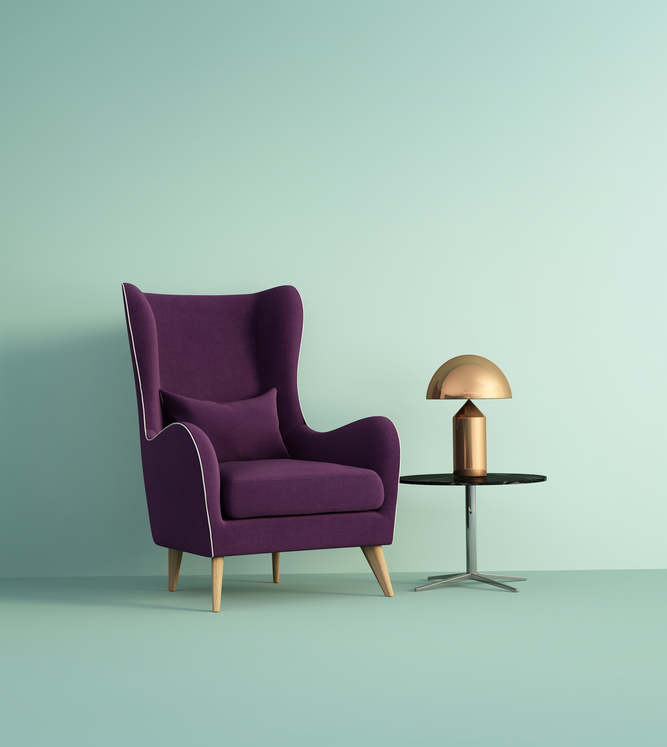 Violet armchair over pale green wall